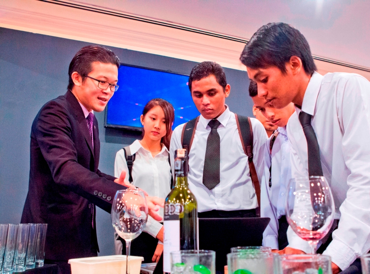 Photo 2 - Sommelier Kevin Yee giving briefing to college student